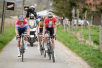 Kasper Asgreen (DEN/Deceuninck - Quick Step) with wonder-duo Mathieu Van der Poel (NED/Alpecin-Fenix) & Wout van Aert (BEL/Jumbo-Visma) up the early section of the Oude Kwaremont<br /> <br /> 105th Ronde van Vlaanderen 2021 (MEN1.UWT)<br /> <br /> 1 day race from Antwerp to Oudenaarde (BEL/264km) <br /> <br /> ©kramon