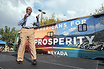 Former presidental candidate Herman Cain addresses a crowd of GOP supporters at an Americans for Prosperity rally in Reno, Nev., on Monday, July 23, 2012. The stop is part of a statewide bus tour protesting President Obama's policies..Photo by Cathleen Allison