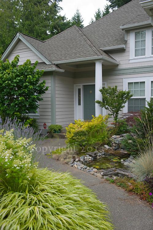 Walkway to Tan House with Green Door