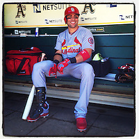 OAKLAND, CA - JUNE 29:  Instagram of Carlos Beltran of the St. Louis Cardinals sitting in the dugout before the game against the Oakland Athletics at O.co Coliseum on June 29, 2013 in Oakland, California. Photo by Brad Mangin
