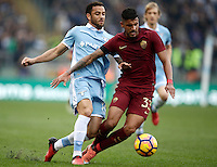 Calcio, Serie A: Lazio vs Roma. Roma, stadio Olimpico, 4 dicembre 2016.<br /> Roma's Emerson Palmieri, right, is challenged by Lazio's Felipe Anderson during the Italian Serie A football match between Lazio and Rome at Rome's Olympic stadium, 4 December 2016. Roma won 2-0.<br /> UPDATE IMAGES PRESS/Isabella Bonotto