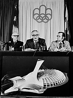 Le Maire Jean Drapeau lors d'une<br /> Conference de presse du COJO,<br /> le 3 Janvier 1973,<br /> <br /> <br />  de gauche à droite, monsieur Feu Gerry Snyder, membre du comité exécutif de la VdeM, Feu Jean Drapeau, maire de Montréal, Feu Roger Rousseau, Président et Commissaire Général du COJO pour les Jeux de la XXIième Olympiade, et  Louis Chantigny, Directeur de la recherche et information COJO.<br /> <br /> <br /> <br /> PHOTO  : Agence Quebec Presse - Alain Renaud