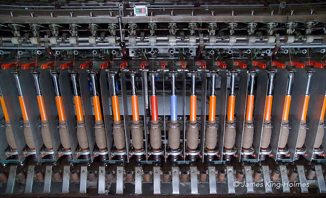 Detail of the bobbins of a spinning machine used for the prodcution of organic wool. Photographed at the Natural Fibre Company Ltd, Launceston, UK.