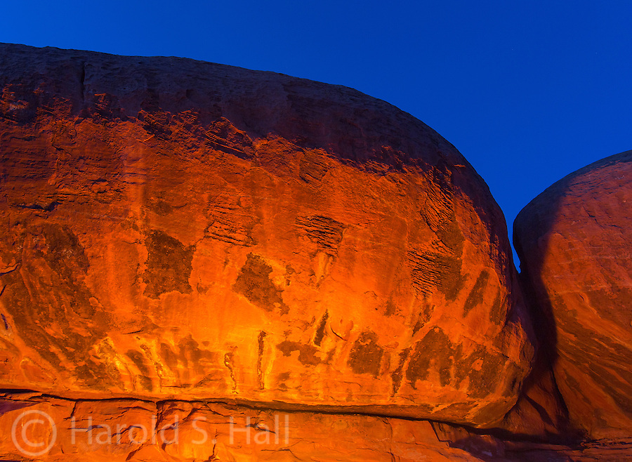 The cliffs around the Toroweep Campground glow from an evening campfire in the Grand Canyon National Park.