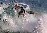 Body boarders and skim boarders do all sorts of tricks off the shores of Sandy Beach in Honolulu, Hi,