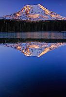 Mount Adams reflected in icy Takhlakh Lake at sunset, South Cascades Mountain Range, Washington State