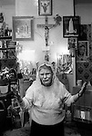 Mrs Nora Arthurs, a Catholic Voice-Box, Seer and Mystic, in her home know as 'Mary's House', on Roggel Road, Canvey Island, Essex UK conducting a prayer meeting. 1996.<br /> <br /> Mrs Nora Arthurs 1916 - 2011.
