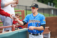Akron RubberDucks center fielder Bradley Zimmer (6) signs autographs before the first game of a doubleheader against the Bowie Baysox on June 5, 2016 at Prince George's Stadium in Bowie, Maryland.  Bowie defeated Akron 6-0.  (Mike Janes/Four Seam Images)