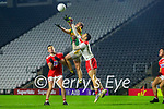 Stephen O'Brien, Kerry in action against Maurice Shanley, Cork, and Micheál Martin, Cork, during the Munster GAA Football Senior Championship Semi-Final match between Cork and Kerry at Páirc Uí Chaoimh in Cork.