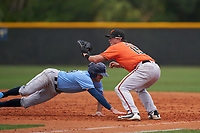 Baltimore Orioles first baseman Toby Welk (15) waits for a throw as Seaver Whalen (79) dives back to the bag during a Minor League Spring Training game against the Tampa Bay Rays on April 23, 2021 at Charlotte Sports Park in Port Charlotte, Florida.  (Mike Janes/Four Seam Images)