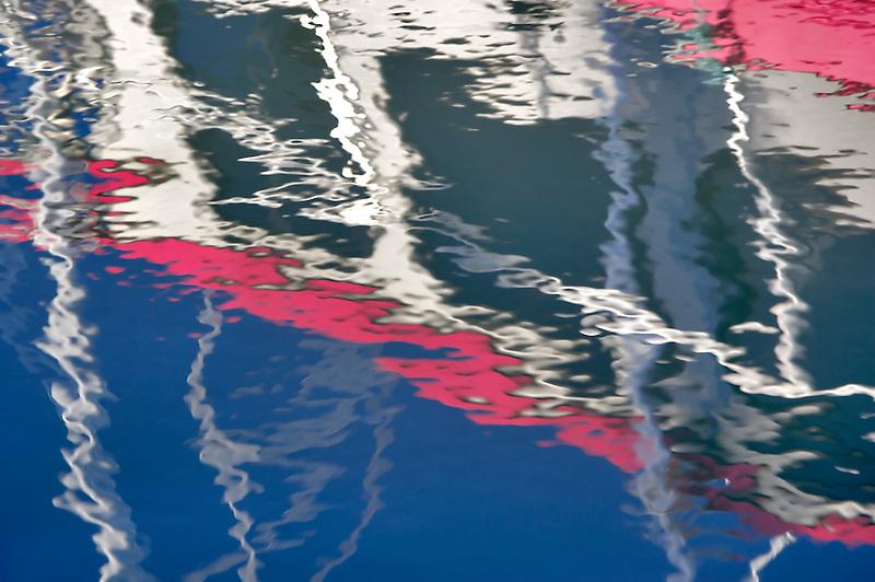 Boat reflected in harbor water. Garibaldi boat harbor. Oregon