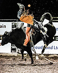 bull ride ends with airtime at the Rooftop Rodeo, Estes Park, Colorado, USA