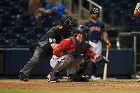 Umpire Greg Gibson and Washington Nationals catcher Yan Gomes (10) during a Major League Spring Training game against the Houston Astros on March 19, 2021 at The Ballpark of the Palm Beaches in Palm Beach, Florida.  (Mike Janes/Four Seam Images)