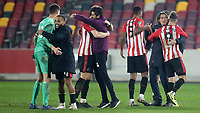Brentford Manager, Thomas Frank celebrates their victory at the final whistle with Emiliano Marcondes during Brentford vs Newcastle United, Carabao Cup Football at the Brentford Community Stadium on 22nd December 2020