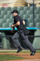 Home plate umpire Colin Baron hustles to get in position during the South Atlantic League game between the Delmarva Shorebirds and the Kannapolis Intimidators at Kannapolis Intimidators Stadium on May 19, 2019 in Kannapolis, North Carolina. The Shorebirds defeated the Intimidators 9-3. (Brian Westerholt/Four Seam Images)