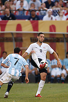United States midfielder Clint Dempsey (8) and Argentina midfielder Maximiliano Rodriguez (7). The men's national teams of the United States and Argentina played to a 0-0 tie during an international friendly at Giants Stadium in East Rutherford, NJ, on June 8, 2008.