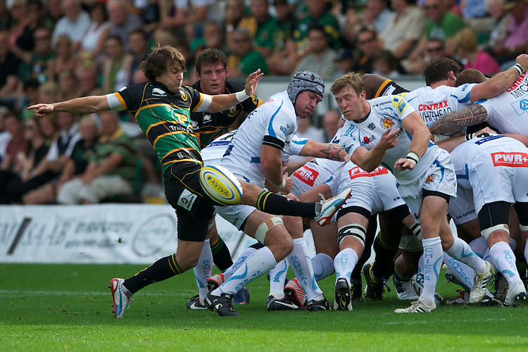 Lee Dickson of Northampton Saints (left) attempts to block the pass of Will Chudley of Exeter Chiefs during the Aviva Premiership match between Northampton Saints and Exeter Chiefs at Franklin's Gardens on Sunday 9th September 2012 (Photo by Rob Munro)