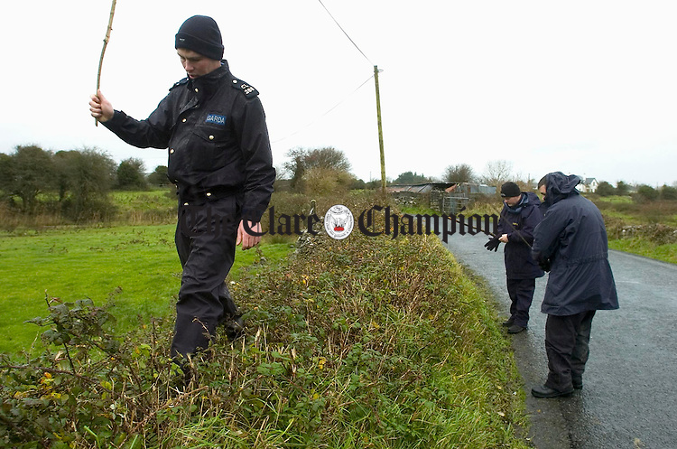 Gardai conduct a search of the area on the roadway at Lissane following the discovery of  Maria Talbot (42) who was unconscious and later died in hospital. Photograph by John Kelly.