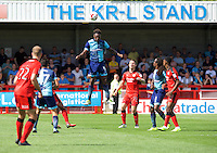 Anthony Stewart of Wycombe Wanderers heads the ball clear during the Sky Bet League 2 match between Crawley Town and Wycombe Wanderers at Broadfield Stadium, Crawley, England on 6 August 2016. Photo by Alan  Stanford / PRiME Media Images.