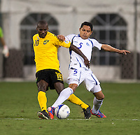 Victor Turcios (5) of El Salvador fights for the ball with Omar Cummings (10) of Jamaica at RFK Stadium in Washington, DC.  Jamaica defeated El Salvador, 2-0.