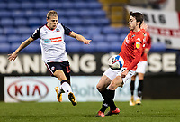 Bolton Wanderers' Lloyd Isgrove competing with Salford City's Luke Burgess (right) <br /> <br /> Photographer Andrew Kearns/CameraSport<br /> <br /> The EFL Sky Bet League Two - Bolton Wanderers v Salford City - Friday 13th November 2020 - University of Bolton Stadium - Bolton<br /> <br /> World Copyright © 2020 CameraSport. All rights reserved. 43 Linden Ave. Countesthorpe. Leicester. England. LE8 5PG - Tel: +44 (0) 116 277 4147 - admin@camerasport.com - www.camerasport.com