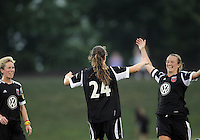 BOYDS, MARYLAND-JULY 07,2012:  Marisa Abegg (5) of DC United Women congratulates Andi Sullivan 24 after she scored the third goal against the Dayton Dutch Lions during a W League game at Maryland Soccerplex, in Boyds, Maryland. DC United women won 4-1.
