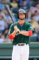 First baseman Sam Travis (28) of the Greenville Drive bats in a game against the Savannah Sand Gnats on Sunday, August 24, 2014, at Fluor Field at the West End in Greenville, South Carolina. Travis is a second-round pick of the Boston Red Sox in the 2014 First-Year Player Draft out of Indiana University. Greenville won, 8-5. (Tom Priddy/Four Seam Images)