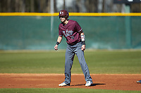Anthony Stehlin (12) of the Concord Mountain Lions takes his lead off of second base against the Wingate Bulldogs at Ron Christopher Stadium on February 2, 2020 in Wingate, North Carolina. The Mountain Lions defeated the Bulldogs 12-11. (Brian Westerholt/Four Seam Images)