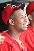 Pitcher Anderson Espinoza (23) of the Greenville Drive sits in the dugout during a game against the Greensboro Grasshoppers, which would be his last with the team, on Thursday, July 14, 2016, at Fluor Field at the West End in Greenville, South Carolina. Greenville won, 3-1. Espinoza was being traded while the game was in progress. (Tom Priddy/Four Seam Images)