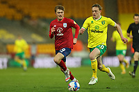 6th April 2021; Carrow Road, Norwich, Norfolk, England, English Football League Championship Football, Norwich versus Huddersfield Town; Oliver Skipp of Norwich City takes on Scott High of Huddersfield Town