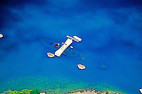 Great aerial shot of Arizona Memorial at Pearl Harbor on Oahu, surrounded by the deep blue Pacific ocean.