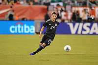 EAST RUTHERFORD, NJ - SEPTEMBER 7: Roberto Alvarado #24 of Mexico kicks the ball during a game between Mexico and USMNT at MetLife Stadium on September 6, 2019 in East Rutherford, New Jersey.