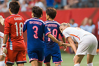 June 23, 2015: Azusa IWASHIMIZU of Japan and Vivianne MIEDEMA shake hands after the end of a round of 16 match between Japan and Netherlands at the FIFA Women's World Cup Canada 2015 at BC Place Stadium on 23 June 2015 in Vancouver, Canada. Japan won 2-1. Sydney Low/AsteriskImages.com