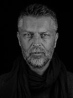 Portrait made using ultraviolet light of VII photographer Joachim Ladefoged.