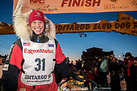 Aliy Zirkle poses at the finish line in Nome after completing the race in 15th place on Wednesday March 14th during the 2018 Iditarod Sled Dog Race.  <br /> <br /> Photo by Jeff Schultz/SchultzPhoto.com  (C) 2018  ALL RIGHTS RESERVED