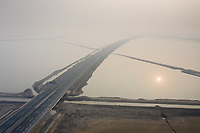 A highway passes over aquaculture farmland near the town of Ninghe, in eastern Tianjin. This stretch of coastline has been highlighted as one of the most vulnerable in China and will be one of the first to feel the impacts of rising sea levels and increased storm surges. 2019