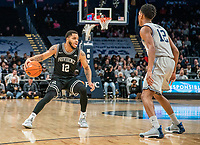 WASHINGTON, DC - FEBRUARY 19: Terrell Allen #12 of Georgetown defends against Luwane Pipkins #12 of Providence during a game between Providence and Georgetown at Capital One Arena on February 19, 2020 in Washington, DC.