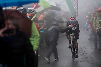 getting a helping hand up the extremely wet, cold & misty Cole di Mortirolo <br /> <br /> Stage 16: Lovere to Ponte di Legno (194km)<br /> 102nd Giro d'Italia 2019<br /> <br /> ©kramon