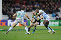 Mike Brown of Harlequins is tackled by Virimi Vakatawa of Racing Metro 92 as Jamie Roberts of Racing Metro 92 supports during the Heineken Cup match between Harlequins and Racing Metro 92 at the Twickenham Stoop on Sunday 15th December 2013 (Photo by Rob Munro)