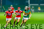 Kerry's Michael Slattery on a solo run as Cork's Ciaran Joyce gives chase and his team mate Sam Quirke keeps an eye on proceedings, in the Munster Under 20 Hurling Championship Quarter-Final