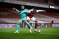 April 3rd 2021; Emriates Stadium, London, England;  Liverpools Mohamed Salah is tackled by Arsenals Gabriel Magalhaes during the Premier League match between Arsenal and Liverpool at the Emirates Stadium in London