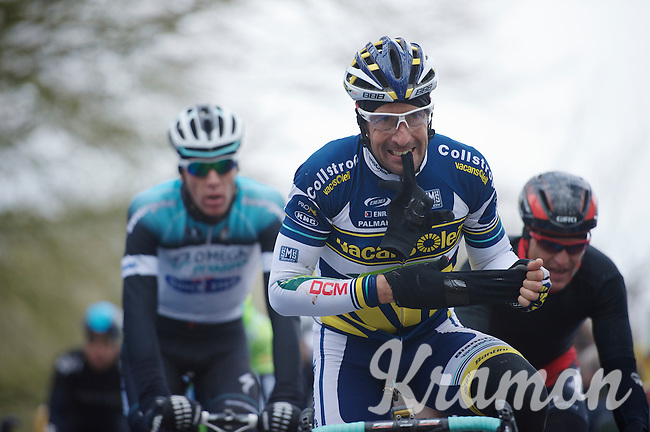 Gent-Wevelgem 2013.Juan Antonio Flecha (ESP) getting rid of his gloves on top of the Kemmelberg (2nd ascent).