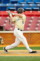 Conor Keniry #14 of the Wake Forest Demon Deacons follows through on his swing against the Virginia Tech Hokies at Wake Forest Baseball Park on April 21, 2012 in Winston-Salem, North Carolina.  The Demon Deacons defeated the Hokies 8-6.  (Brian Westerholt/Four Seam Images)