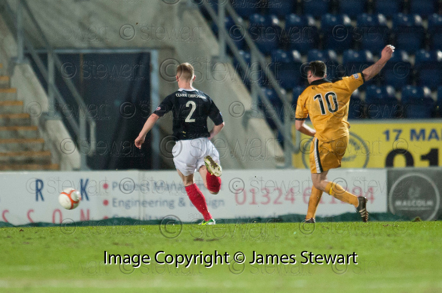 Dumbarton's Garry Fleming scores their third goal.
