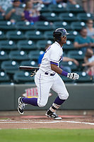 Louis Silverio (15) of the Winston-Salem Dash follows through on his swing against the Buies Creek Astros at BB&T Ballpark on April 13, 2017 in Winston-Salem, North Carolina.  The Dash defeated the Astros 7-1.  (Brian Westerholt/Four Seam Images)