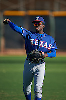 Texas Rangers Eric Jenkins (92) warms up before an instructional league game against the San Diego Padres on October 9, 2015 at the Surprise Stadium Training Complex in Surprise, Arizona.  (Mike Janes/Four Seam Images)