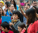 Parents and staff watch during a groundbreaking ceremony for the new Mandarin Chinese Language Immersion Magnet School, December 6, 2014.