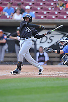 Quad Cities River Bandits left fielder Bryan De La Cruz (30) swings during a game against the Wisconsin Timber Rattlers at Fox Cities Stadium on June 27, 2017 in Appleton, Wisconsin.  Wisconsin lost 6-5.  (Dennis Hubbard/Four Seam Images)