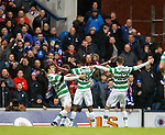 Moussa Dembele celebrates his goal to the Rangers support