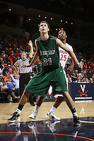 CHARLOTTESVILLE, VA- NOVEMBER 26:  Alec Brown #21 of the Green Bay Phoenix looks for the rebound during the game on November 26, 2011 at the John Paul Jones Arena in Charlottesville, Virginia. Virginia defeated Green Bay 68-42. (Photo by Andrew Shurtleff/Getty Images) *** Local Caption *** Alec Brown